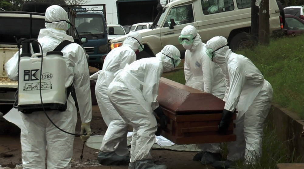 Burial of an Ebola victim. Photo by Alexander Ush Wiaplah.