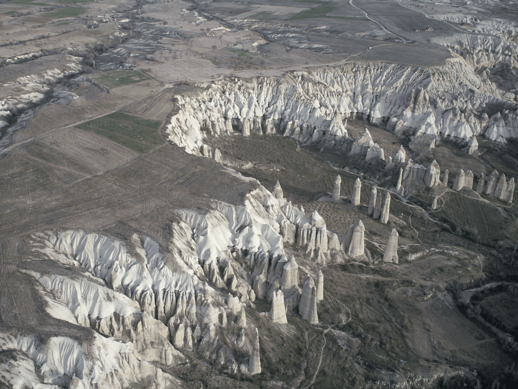 "Simulated annealing algorithms work to find the optimal solution in a ""landscape"" of peaks and valleys representing different costs. (Cappadocia, Turkey. Photo by Frank and Rosalind Reinhard)"