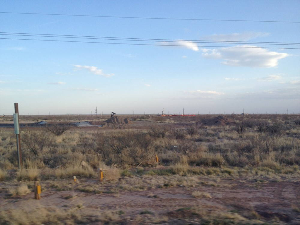 Fig. 1 Oil landscape with pump jack just east of Midland, Texas, along I-20. Photo by author, March, 2013.