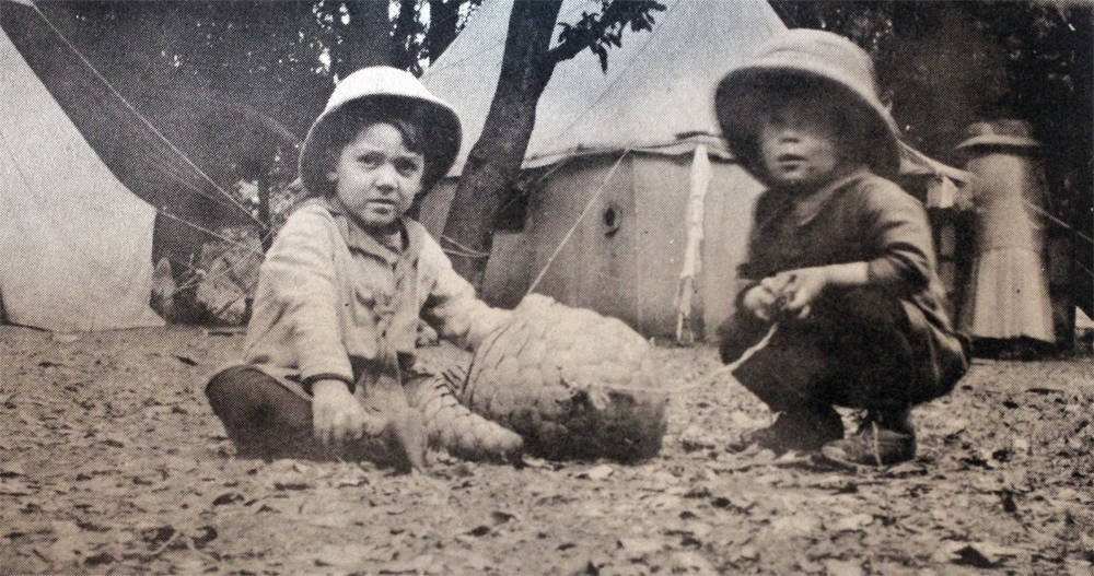 "Carl (""Bapu"") Taylor (on right), and his brother, John C. Taylor Jr., with an Indian anteater captured after it wandered into camp. Circa 1919. Photo by Beth Taylor, and taken from India: Dr. John Taylor Remembers the Period from 1914-1967 (World Presbyterian Missions, 1973)."