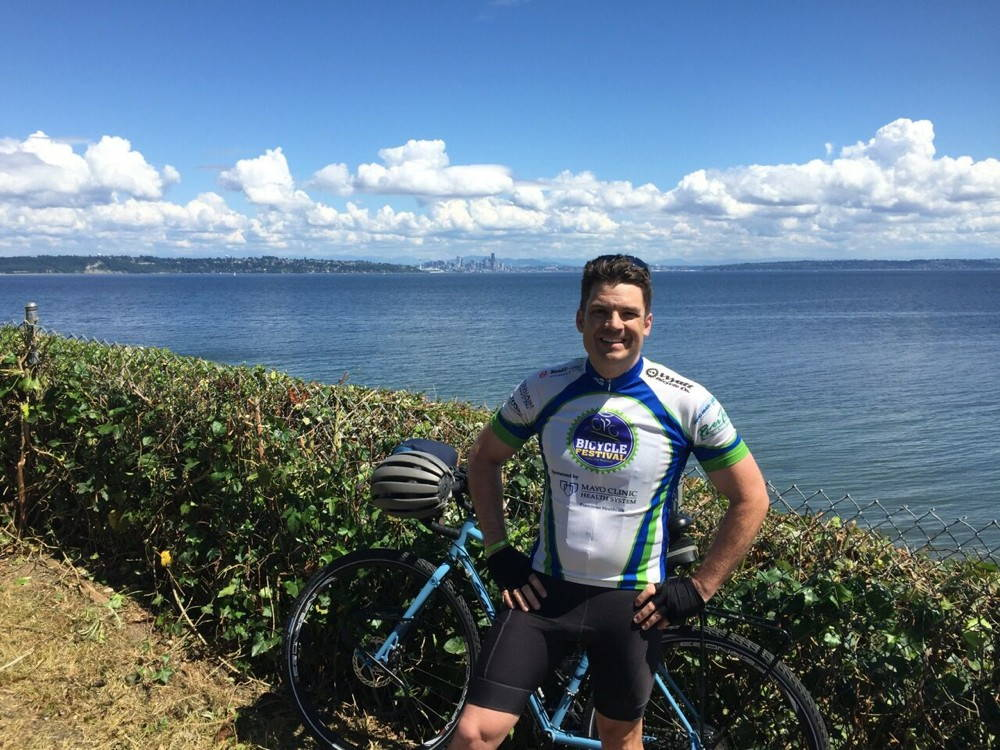 "Longhurst has been giving the ""public"" humanities a whole new meaning during the Bike Battles bike/book tour. Here's the author during a recent stop on Bainbridge Island, Washington."