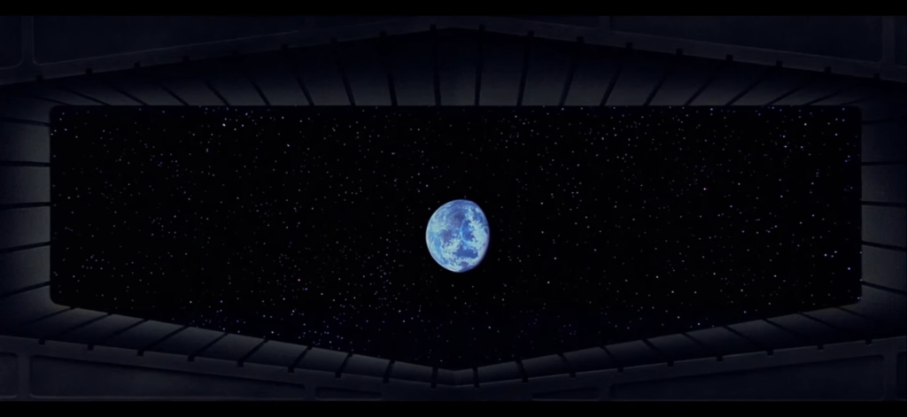 "Alderaan, as seen from the Death Star, hanging in the balance. <a href=""https://www.youtube.com/watch?v=p0qLzsIhUMk"">Screenshot</a>."