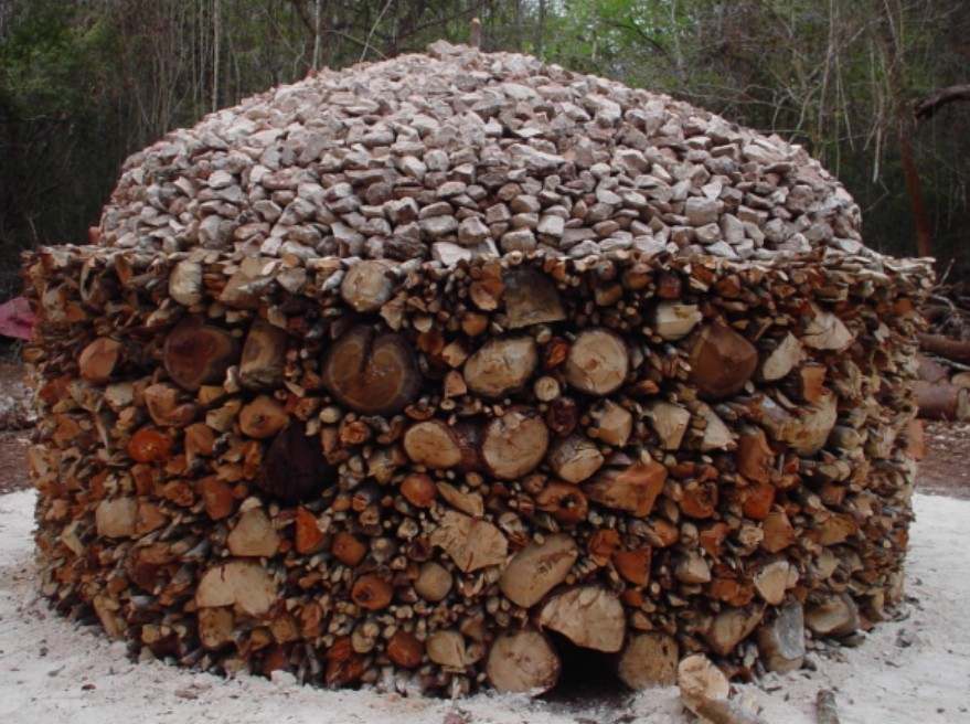 A traditional Maya lime production pyre (or calera), constructed and fired by Tomás Gallareta Negrón and Rossana May Ciau during the 2002 excavation of the Prehispanic Maya site of Labná in the Puuc Region of the Northern Yucatan Peninsula. Photo by Rossana May Ciau.