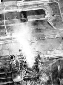 Chernobyl aerial view into the core, with smoke from the graphite fire and core meltdown. Fair use.
