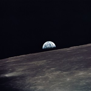 A view of Earth rising above the lunar horizon photographed from the Apollo 10 Lunar Module, looking west in the direction of travel. The Lunar Module at the time the picture was taken was located above the lunar farside highlands at approximately 105 degrees east longitude. May, 1969. Photo courtesy of NASA. Care