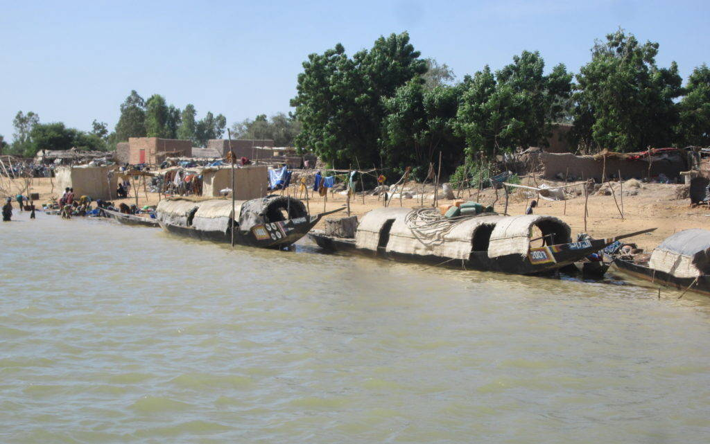 Small transport boats along the banks of a Niger Delta village. Photograph by Matt Turner on November 4, 2014.