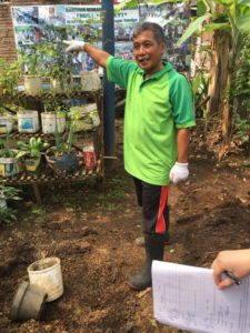 Bapak Gito explains how trash becomes a garden at Bank Sampah Makmur, Salatiga. Photo by Elyssa Burns.