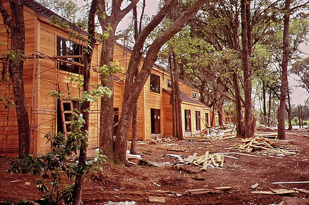 A set of houses under construction at Sea Pines Plantation in 1973. Builders had to avoid removing trees during construction or risk the penalty of strict fines from the Sea Pines Company. Photo by Paul Conklin, U.S. Environmental Protection Agency, 1973.