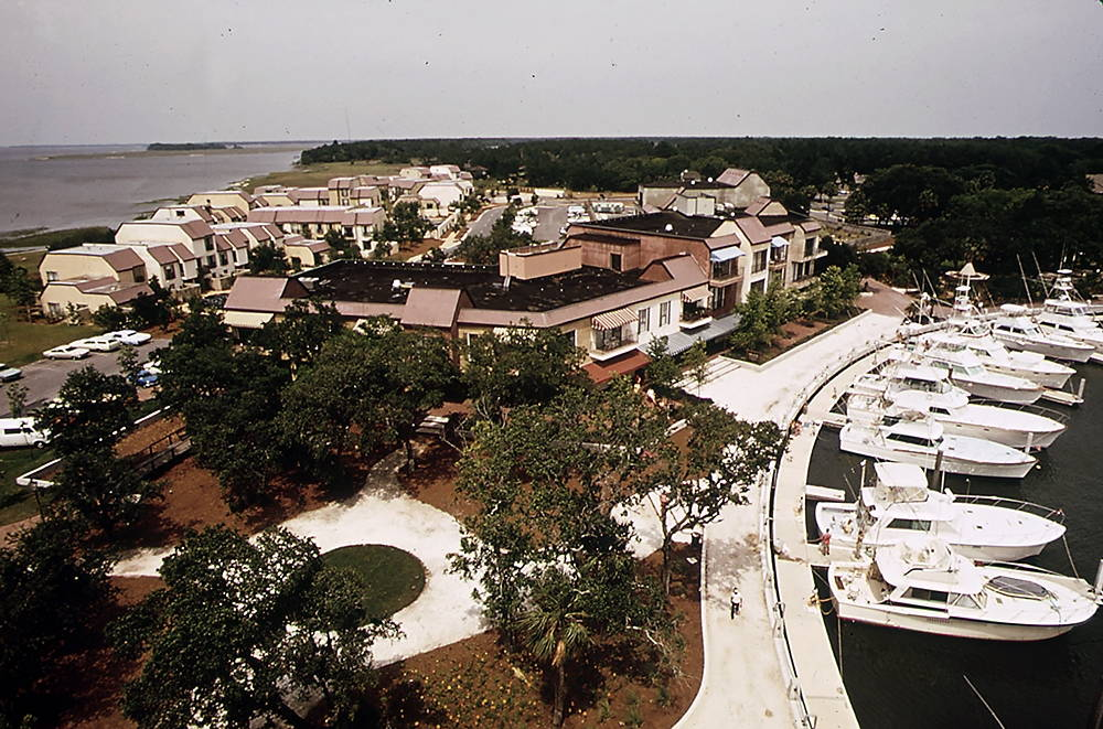The harbor, shops, marina, and villas at Harbour Town, the epicenter of Sea Pines Plantation. The artificial harbor cost more than $7 million to dredge, degrading water quality in the nearby Harbor River and Calibogue Sound. Photo by Paul Conklin, U.S. Environmental Protection Agency, 1973.