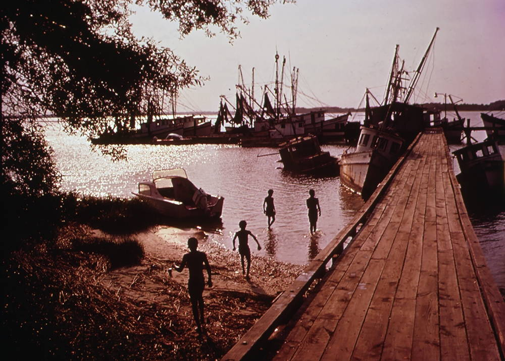 The shrimp fleet of the Hilton Head Fishing Cooperative, an organization of African American fishermen from Hilton Head Island, South Carolina. In 1969 members joined with Charles Fraser in a fight to keep a major petrochemical manufacturer out of the area. Photo by Paul Conklin, U.S. Environmental Protection Agency, 1973.