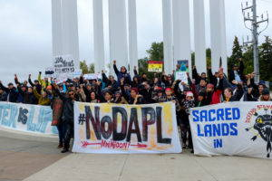 Demonstrators, led by activists from the Indigenous Environmental Network, gather in Bismarck, North Dakota to speak out against the proposed Dakota Access pipeline. Image by author, September 2016.
