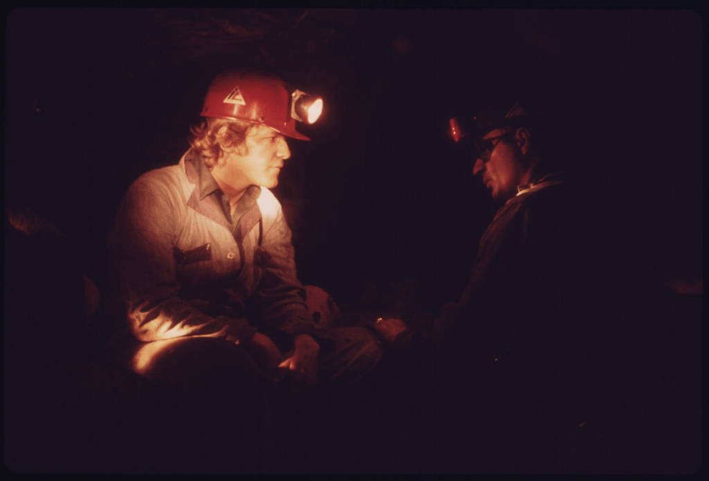 Veteran miner Harold Stanley, right, talks to a young miner who has come into this Richlands, Virginia, mine for the first time. Photo by Jack Corn, U.S. Environmental Protection Agency, April 1974.