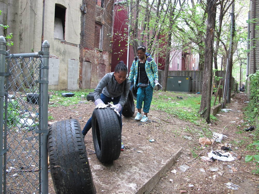 Youth in Baltimore participate in one the research team's interventions: a tire drive to collect discarded tires. Tires are sites of mosquito breeding. Photo by Joel Baker, 2016.