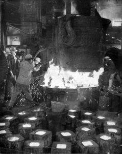 Steel production in China during the late 1950s. Photo by Li Jiuling, 1957, via Wikimedia Commons.
