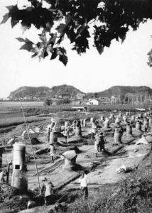Backyard furnaces in China during the Great Leap Forward. Author unknown, 1958, via Wikimedia Commons.