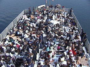 Deck of the U.S. Coast Guard Cutter Legare with 301 Haitian migrants rescued on the Caribbean Sea in 2001. Image from Wikimedia Commons.