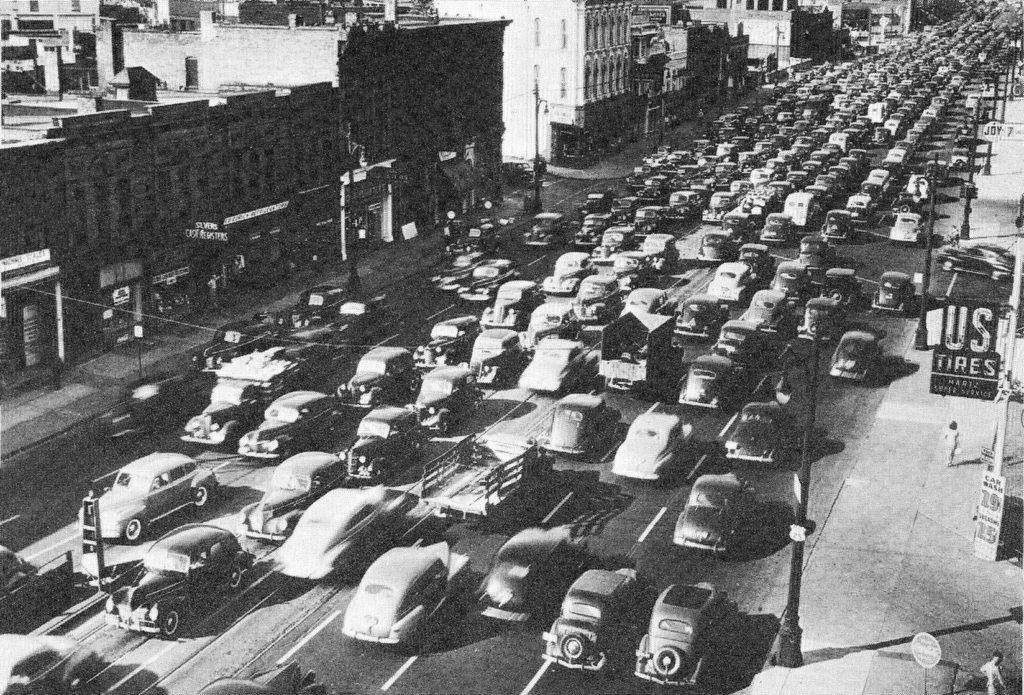 Traffic jams became increasingly common as more Americans purchased cars and commuted from suburbs to city.
