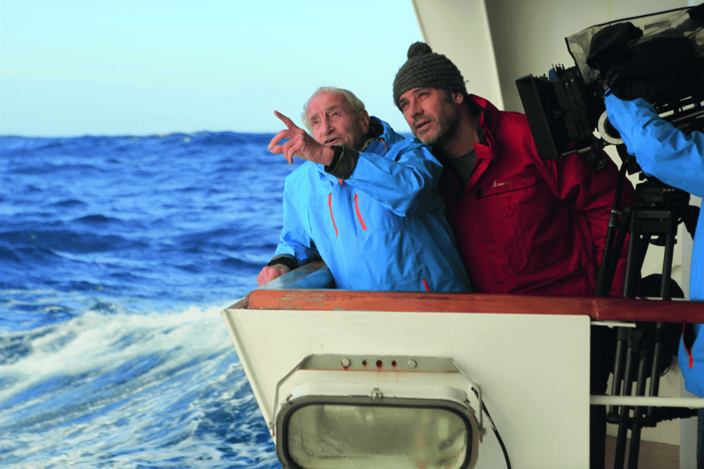 Director Luc Jacquet right, uses a voiceover narrator to represent the perspective of scientist Claude Lorius, left. Image courtesy of Marc Perrey.