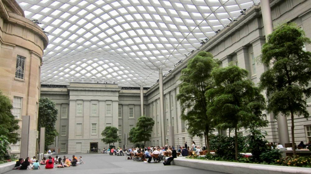 "In the nineteenth century, the Patent Office Building housed a ""cabinet of curiosities"" for tourists. Today, visitors enjoy the Kogod Courtyard. Image courtesy of <a href=""https://commons.wikimedia.org/wiki/File:Kogod_Courtyard_-_Old_Patent_Office_Building.JPG"" target=""_blank"" rel=""noopener"">Wikimedia Commons</a>."