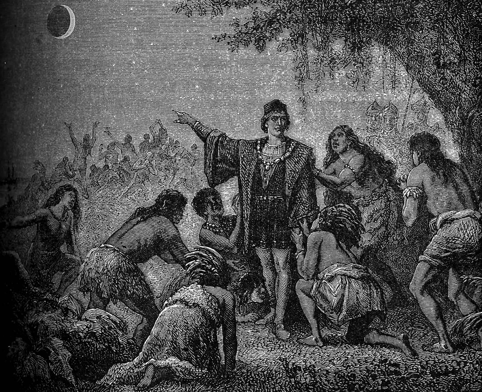 A man in Western dress points at the moon during an eclipse while indigenous people surround him.