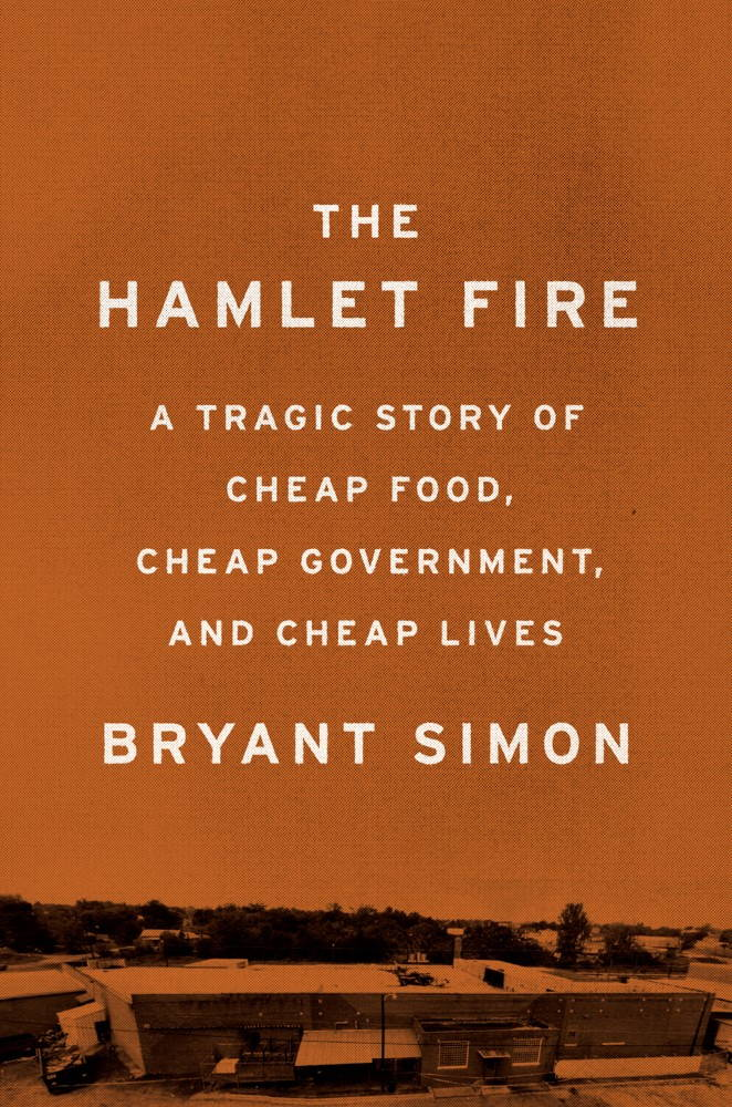 "The jacket image of ""The Hamlet Fire: A Tragic Story of Cheap Food, Cheap Government, and Cheap Lives"" by Bryant Simon. The title appears on a yellow background above a photograph of a food processing facility."