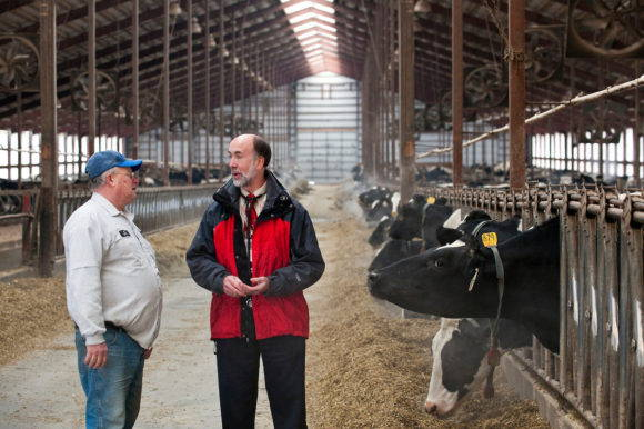 The Wisconsin Idea in action. Byron Crouse (right), associate dean in the School of Medicine and Public Health at the University of Wisconsin–Madison, meets with Jim Fahey (left), the owner of Praireland Dairy near Belleville, Wisconsin. Crouse has helped to create Co-op Care, a program designed to increase the number of farmers and other rural business owners that have access to affordable health insurance programs with benefits that include preventative services. Photo by Bryce Richter, December 2008. Courtesy of UW–Madison University Communications.
