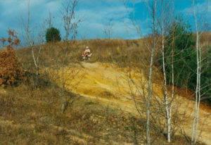 An ATV rider overlooks land damaged by ATVs