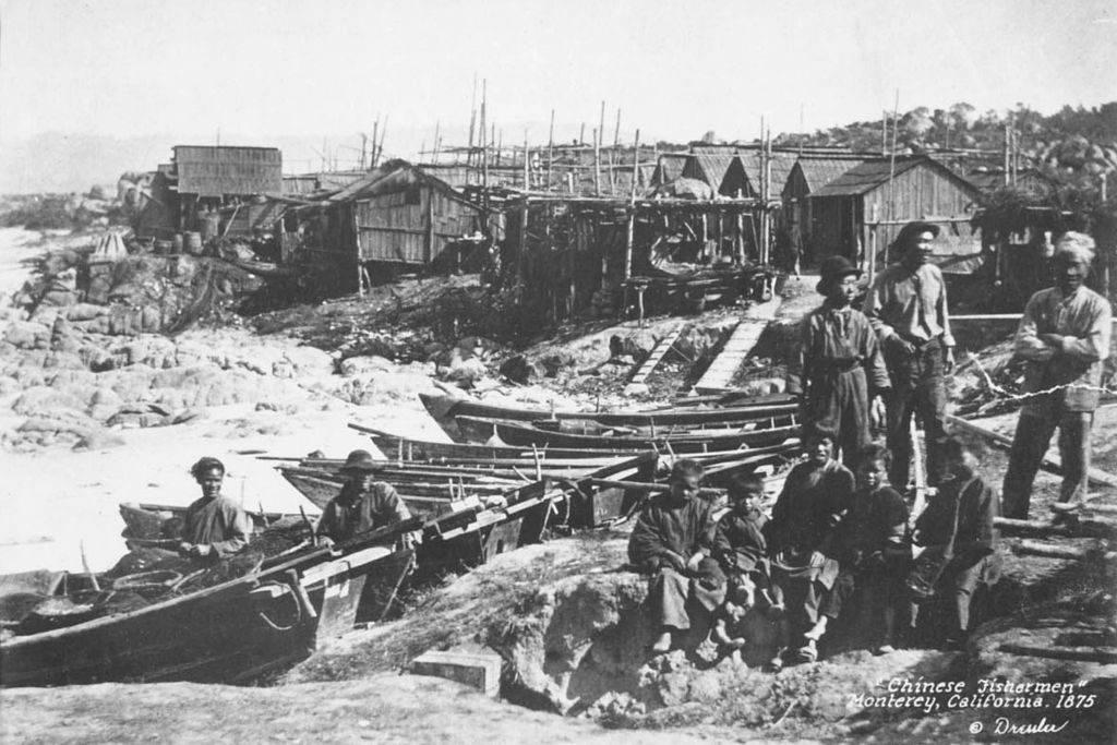 Chinese- American fishermen and children in Monterey, California, 1875.