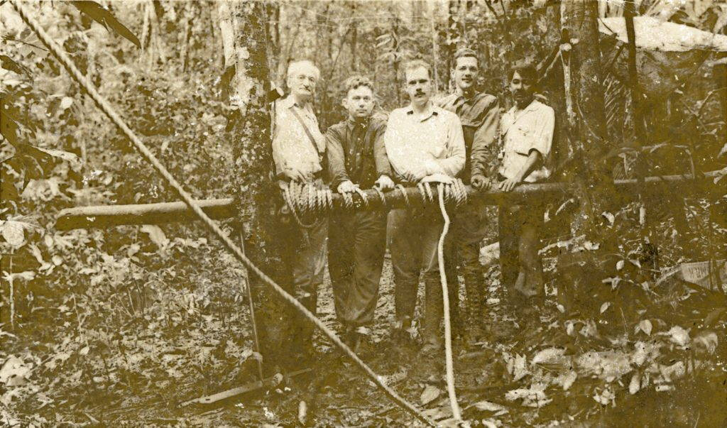 Alexander Petrunkevitch (Yale), Paul D. Voth (University of Chicago), Orlando Park (Northwestern), Eliot C. Williams (Park's graduate student), and Fernando Jaen (left to right) at Shannon Trail 1.5, 4 August 1938. The rope in the foreground was attached to a pulley to enable some access to the forest canopy. Photographer unknown. Digital reproduction provided by the Smithsonian Tropical Research Institute, file referee no. 33869.