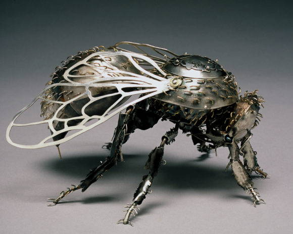 A sterling silver sculpture of a honeybee